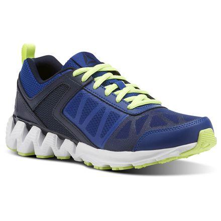 Reebok Zig Kick 2K18 Grade School Kids Running Shoes in Collegiate Royal / Navy / Flash / White