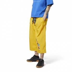 Reebok by Pyer Moss Men's Lifestyle Long Shorts in Fierce Gold